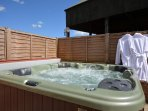 Relax in the private hot tub