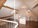 Master bedroom en-suite accessed via a spiral staircase