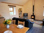 Lounge/ dining area with woodburner