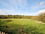 Views over neighbouring meadows and woodland