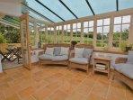 Spacious conservatory leading to the veranda