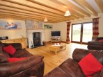 Lounge with woodburner and french doors to the garden