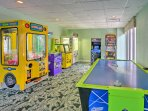 Everyone will love playing a round of air hockey in the game room.
