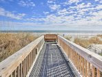 When you're ready, follow the boardwalk to the expansive beach.