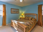 The master bedroom has a comfortable king bed!