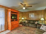 Relax on one of the 2 comfortable leather couches and watch your favorite show on the flat-screen cable TV in the...