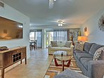 The first-floor condo is directly on the beach and features community amenities.