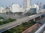 BTS SkyTrain crosses the river in front of the condo building