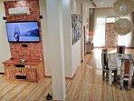 Huge 90m2 living room with 65' smart tv, home cinema sofa, two ac, blue ray home cinema system.