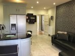 Fully fitted kitchen with leather corner suite to relax on