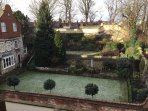 Views over neighbouring gardens and historic walls from main bedroom