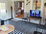 Sun Room off of Kitchen with TV,  opens to Bluestone Patio Dining and Grill Area