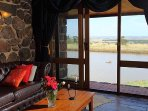 Tuki Stone Cottages - Lounge with view