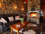 Tuki Stone Cottages- living area with open fire