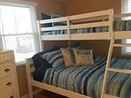 2nd Bedroom Full size under twin bunk. Sleeps 3. Plus a dresser and flat screen TV Cable Internet