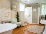 Master bathroom with shower and claw foot tub