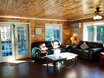 Huge open concept family room with mini split that provides air conditioning.
