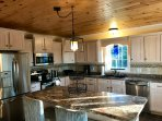 Gorgeous kitchen with all stainless steel appliances. Full pantry with pull out drawers.