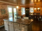 6 foot island with bar stools. Open concept kitchen/dining with ocean views.