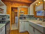 Boasting granite countertops and stainless steel appliances, the kitchen is truly top-notch.