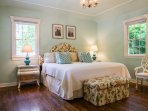 Pool house master bedroom with king bed and ensuite bathroom