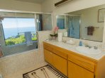Second bath adjacent to second bedroom has west-facing ocean views, infinity shower/tub.