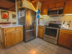 Kitchen offers stainless steel appliances, including convection range.