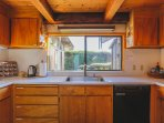Spacious, light-filled, well-equipped kitchen overlooks upper deck.