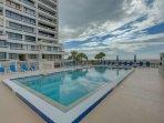The Terrace Community Heated swimming pool with views of Siesta Key Beach.