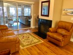 The comfortable seating area surrounds an accent fireplace.