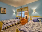 The second bedroom has 2 twin beds for restful slumbers.
