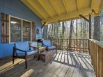 Unwind on the comfortable patio furniture and enjoy the serene, forested surroundings.