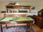 Games room including quarter snooker table.