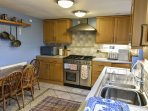 Kitchen with range cooking and everything you need to cook during your stay.