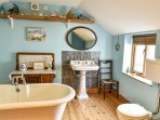 Family bathroom with room topped bath.