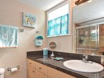 Master ensuite with lots of counter space and drawers.