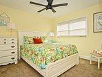 Second bedroom with queen size bed, ample drawers and closet space.