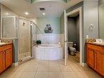 Master bathroom has separate vanities, private lavatory, tub & shower.