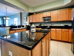 Larger kitchen with stainless steel appliances.