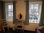 Dressing table with double windows overlooking the river