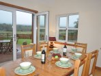 Dining area with french doors leading out to garden