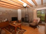 Lounge area with woodburner and countryside views