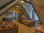 Sleep is sure to come easy in these 2 twin beds in the loft.