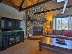 Gather in the cozy living area for a movie night next to the beautiful stone fireplace.