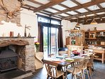 Farmhouse kitchen/diner with exposed beams