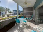 Our bright and comfortable front lanai with a view of the Gulf and beach.