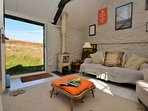 Open-plan living area with woodburner and access to the moor