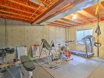 Work up a sweat in the well-equipped home gym.