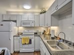 The eat-in kitchen is fully equipped with modern appliances.