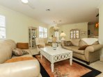 Open concept, yet cozy and welcoming. This living space is bright, cheery, and filled with Florida sunshine!